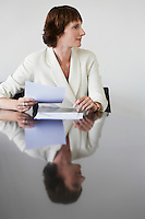 Business woman working at conference table