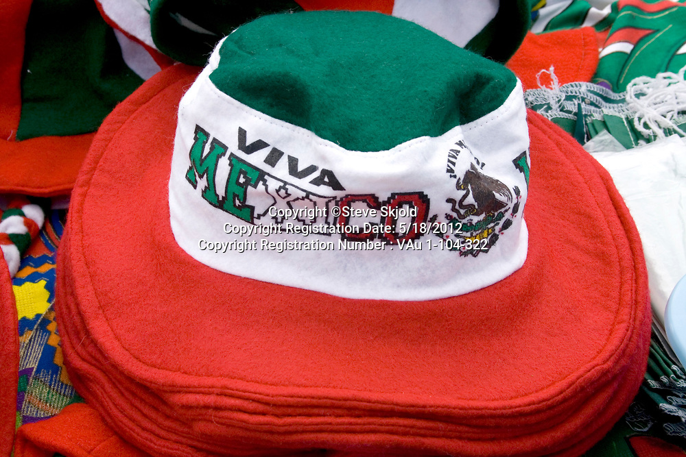 Colorful Viva Mexico brimmed flag hats for sale at sidewalk shop. Mexican Independence Day Minneapolis Minnesota MN USA