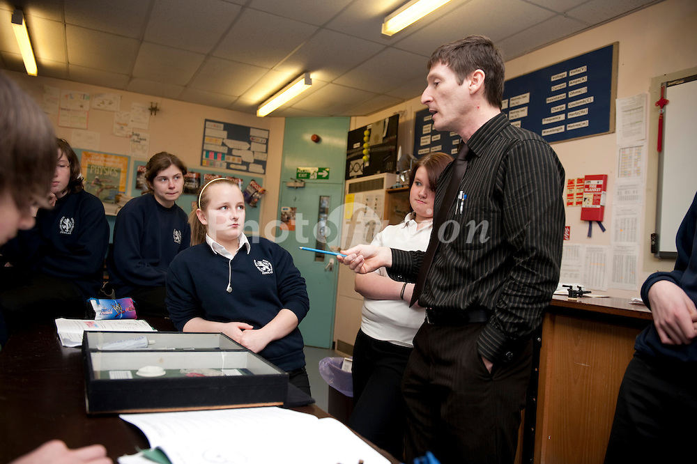 A male teacher teaching Human Reproduction to a group of year 9 pupils at Penglais School; Aberystwyth Wales UK,