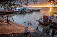 Locals hanging out on the waterfront in Mandalay, Burma.
