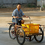 Local cyclo delivery driver in Mae Sot on the Thai-Burmese border. These cheap forms of pedal transport are still in common and daily commercial usage.