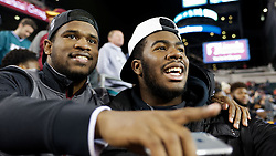 Panthers alumnus and South Carolina University running back Dave Williams and Panthers senior Naseir Upshur, committed to play for Florida State University, watch the Eagles game.<br /> <br /> Check elsewhere on this site for all images of this shoot. Selected images are published as part of photo essay on WHYY's NewsWorks.org. - http://www.newsworks.org/index.php/local/item/89516-young-champions-celebrated-at-eagles-game-photos<br /> <br /> (©2015, All Rights reserved - Bastiaan Slabbers/BasSlabbers.com)