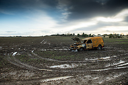 Abandoned burnt out field in farmer's field. A cost to the owner, the insurance company and the farmer.