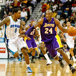 Dec 5, 2012; New Orleans, LA, USA; Los Angeles Lakers shooting guard Kobe Bryant (24) drives past New Orleans Hornets shooting guard Roger Mason Jr. (8) during the second half of a game at the New Orleans Arena. The Lakers defeated the Hornets 103-87.  Mandatory Credit: Derick E. Hingle-USA TODAY Sports