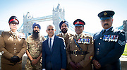 Sadiq Khan poses for a photo with some of the members of the Armed Forces present <br /> <br /> Armed Forces Day - City Hall ceremony pays tribute to British Armed Forces, London, Great Britain 25th June 2018 <br />  <br /> The Mayor of London and the London Assembly joined members of the British Armed Forces at City Hall today for a flag-raising ceremony to honour the courage and commitment of the Armed Forces community.<br /> The annual ceremony took place ahead of National Armed Forces Day, next Saturday, and was attended by members of the Forces as well as veterans, reserves, cadets and representatives from military charities. It is the 10th Armed Forces Day ceremony organised by the Mayor and London Assembly.<br /> <br /> The Mayor, Sadiq Khan and Chair of the London Assembly, Tony Arbour AM, joined senior military figures for the ceremony, which featured musical contributions from the Band of the Royal Yeomanry.<br />  <br /> Naval Commodore David Elford OBE, Army Colonel Victor Matthews OBE and Air Commodore David Prowse OBE from the Royal Air Force offered a joint military response.<br /> The Armed Forces flag was raised by Cadet Cpl Aaron Harmsworth and Cadet Charlotte McCarthy.<br /> <br /> Photograph by Elliott Franks