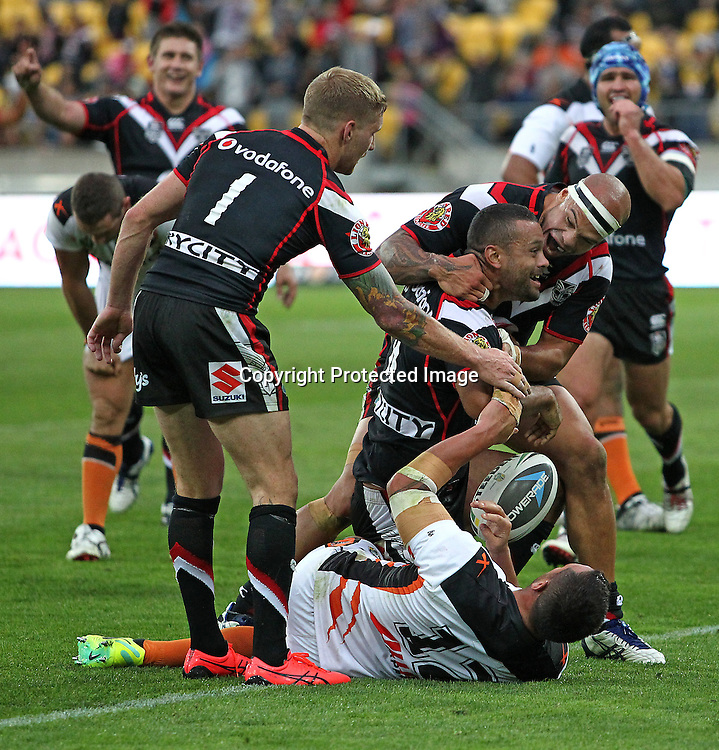 Warriors players celebrate a try to Jayson Bukuya during the NRL match between The Warriors v Wests Tigers. Westpac Stadium, Wellington. 29 March 2014. Photo.: Grant Down / www.photosport.co.nz