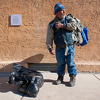 120213       Brian Leddy<br /> Mike Fogg, also known as The Preaching Hitchhiker, pauses while in downtown Gallup Tuesday morning. Fogg was traveling through town on his way to Texas to spend Christmas with his sister.