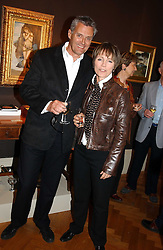 Actor SIMON WILLIAMS and his wife LUCY FLEMING at a party to celebrate the publication of an autobiography by the late Jack Rosenthal at The Fine Art Society, 148 New Bond Street, London W1 on 21st April 2005.<br />