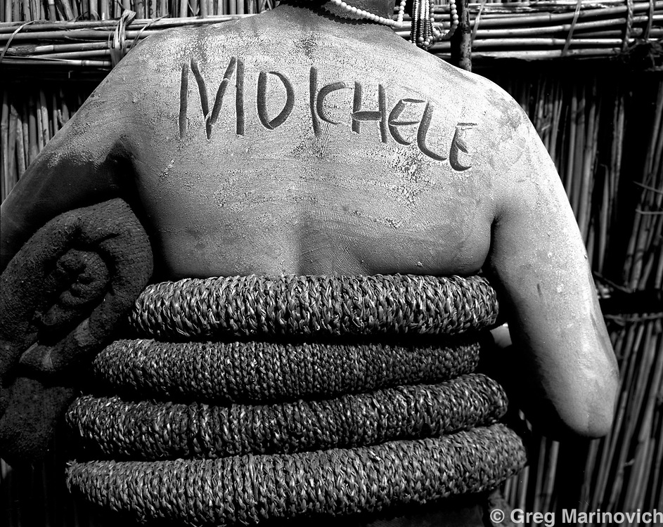 IPMG0360 South Africa, Ficksburg, 2001: Moichelle, one of three clay covered women displays her name during the BaSotho female initiation ceremony known as bale, Bultfontein farm, Free State Province. November 2001. one of three in series..Photograph by Greg Marinovich/South Photographs