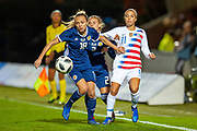 Claire Emslie (#18) (Manchester City) of Scotland holds off Mallory Pugh (#11) (Washington Spirit) of the USA during the Women's International Friendly match between Scotland Women and USA at the Simple Digital Arena, Paisley, Scotland on 13 November 2018.