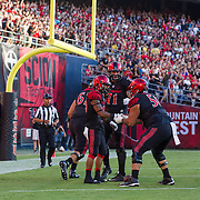 03 September 2016: The San Diego State Aztecs football team open's up the season at home against the University of New Hampshire Wildcats.  San Diego State running back Donnel Pumphrey (19) celebrates with teammates after scoring on a 20 yard run. The Aztecs lead 21-0 at halftime. www.sdsuaztecphotos.com
