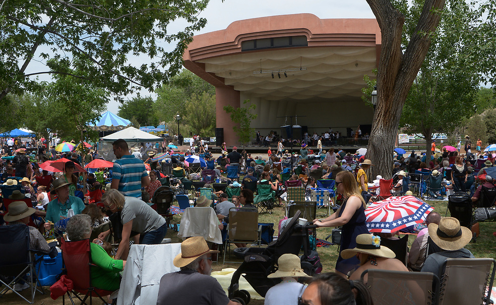 gbs051417b/ASEC -- A large Mother's Day crowd at the ABQBioPark Zoo listen to the New Mexico Philharmonic which performed in the band shell on Sunday, May 14, 2017.(Greg Sorber/Albuquerque Journal)