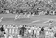 COLLEGE FOOTBALL:   Stanford's Rod Garcia #14 kicks off early in the1972 Rose Bowl game against Michigan played on January 1, 1972 at the Rose Bowl in Pasadena, California. Stanford won by a score of 13-12.  BW R0148-11