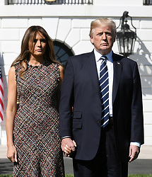 U.S. President Donald Trump and First Lady Melania Trump, lead a moment of silence with White House staff for the victims of the Las Vegas shooting, on the South Lawn of the White House in Washington, D.C., U.S., Oct. 2, 2017. Photo by Olivier Douliery/ Abaca Press