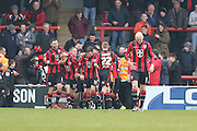 Morecambe Celebrate after Jamie Devitt of Morecambe FC makes it 2-0 from the penalty spot during the Sky Bet League 2 match between Morecambe and AFC Wimbledon at the Globe Arena, Morecambe, England on 12 March 2016. Photo by Stuart Butcher.