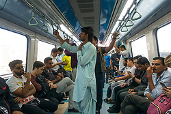 Passengers inside arriage on the Dubai metro, United Arab Emirates