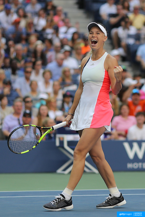 2016 U.S. Open - Day 7  Caroline Wozniacki of Denmark celebrates her win against Madison Keys of the United States in the Women's Singles round four match on Arthur Ashe Stadium on day six of the 2016 US Open Tennis Tournament at the USTA Billie Jean King National Tennis Center on September 4, 2016 in Flushing, Queens, New York City.  (Photo by Tim Clayton/Corbis via Getty Images)