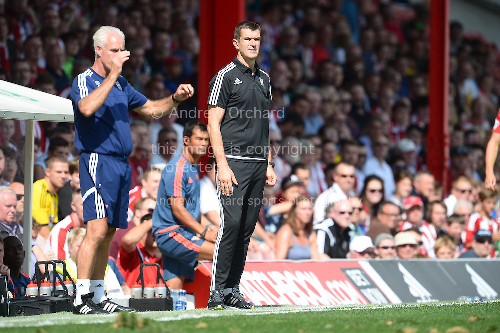 Marinus Dijkhuizen, the Brentford head coach looking on from the touchline. Skybet football league Championship match, Brentford v Ipswich Town at Griffin Park in London on Saturday 8th August 2015.<br /> pic by John Patrick Fletcher, Andrew Orchard sports photography.