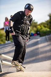Tony Lawrence, skateboarding cop at North Edinburgh Skatepark.