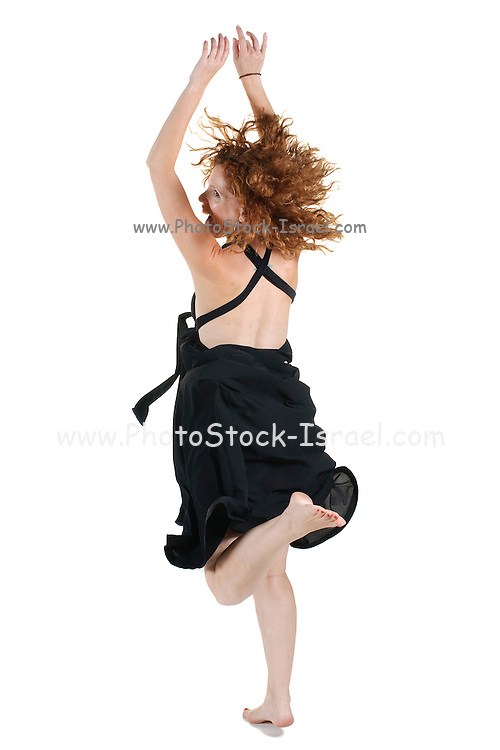 happy fashionable woman of 40 dancing On white Background rear view