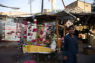 A flower stand where guirlands are sold for wedding and funeral ceremonies. <br /> 19-year-old Sobia was murdered because she and her family refused a marriage proposal by one of their neighbours. <br /> The rejected boy who went to the same school as Sobia, took revenge and slaughtered her violently after first raping her. Karachi, Pakistan, 2011