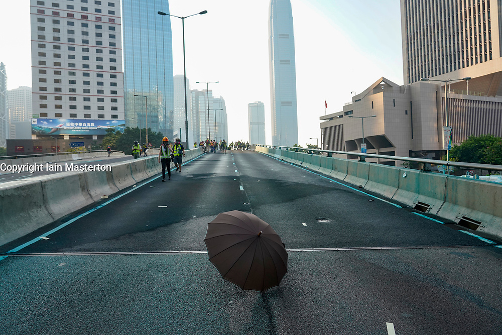 Hong Kong. 1 October 2019. After a peaceful march through Hong Kong Island by an estimated 100,000 pro democracy supporters, violent flared up at Tamar, Admiralty and moved through Wanchai district. Police used teargas and baton rounds and water cannon. Hard core group lit fires, threw bricks and Molotov cocktails at police. Violence continues into evening. Umbrella on flyover near confrontations between police and protestors. Iain Masterton/Alamy Live News.