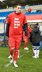 CARDIFF, WALES - Saturday, November 14, 2009: Wales' Andy Dorman runs out wearing a 'Show Racism the Red Card' shirt before the international friendly match against Scotland at the Cardiff City Stadium. (Pic by David Rawcliffe/Propaganda)