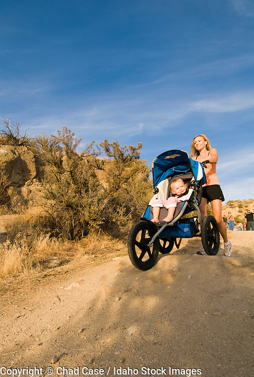 Idaho, Boise . Foothills north of town . Mother daughter walking trails with stroller