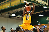 Vermont's Daren Payen (12) dunks the ball during the men's basketball game between the Lyndon State Hornets and the Vermont Catamounts at Patrick Gym on Saturday afternoon November 19, 2016 in Burlington (BRIAN JENKINS/for the FREE PRESS)