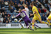Preston North End Striker Eoin Doyle fouled by Milton Keynes Dons goalkeeper Cody Cropper during the Sky Bet Championship match between Preston North End and Milton Keynes Dons at Deepdale, Preston, England on 16 April 2016. Photo by Pete Burns.