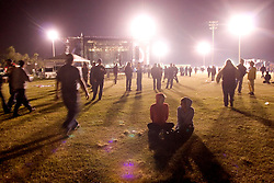 29th Oct, 2005.  After Katrina, New Orleans, Louisiana. Let the good times roll. Voodoo Fest tribute concert at Riverview Park. Spectators wander the park as the event draws to a close.