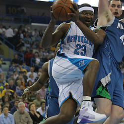 08 February 2009: New Orleans Hornets guard Devin Brown (23) drives past Minnesota Timberwolves forward Kevin Love (42) during a NBA game between the Minnesota Timberwolves and the New Orleans Hornets at the New Orleans Arena in New Orleans, LA.