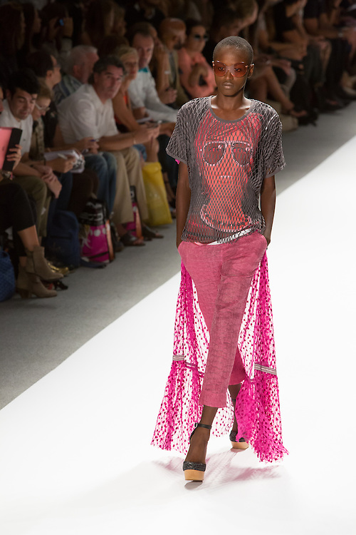 Open weave pants with a print T and gray netting overshirt. By Custo Barcelona at the Spring 2013 Fashion Week show in New York.