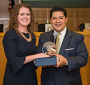 Keeley Simpson receives an Excellence in Leadership award from Houston ISD Superintendent Richard Carranza during a Professional Learning Series meeting, March 1, 2017.