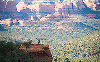 Woman pausing on Devils Bridge hiking trail Sedona Arizona USA&#xA;<br />