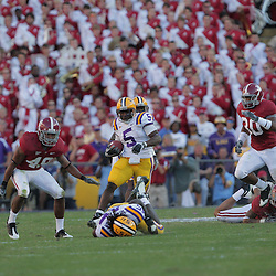08 November 2008: LSU running back Keiland Williams (5) runs away from Alabama defensive back Rashad Johnson (49) and Alabama linebacker Dont'a Hightower (30) during the Alabama Crimson Tide SEC West game against the LSU Tigers at Tiger Stadium in Baton Rouge, LA.