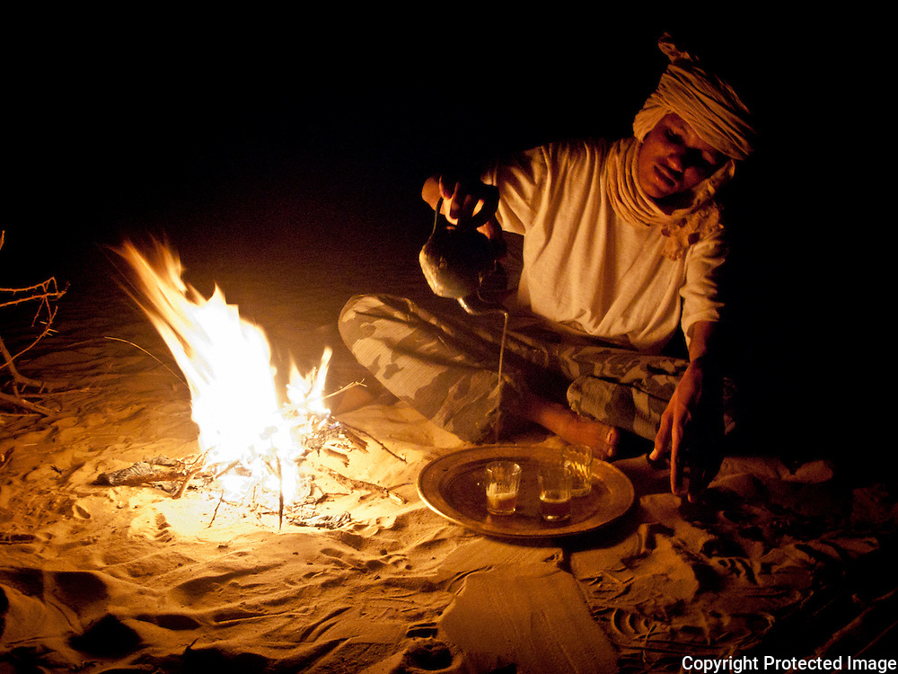 Tuareg tea ceremony in campsite  near Timbuktu, Mali .