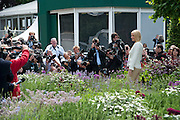 GWYNETH PALTROW IN THE B & Q GARDEN, . The RHS Chelsea Flower Show 2011. The Royal Hospital grounds. Chelsea. London. 23 May 2011. <br /> <br />  , -DO NOT ARCHIVE-© Copyright Photograph by Dafydd Jones. 248 Clapham Rd. London SW9 0PZ. Tel 0207 820 0771. www.dafjones.com.