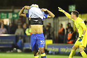 AFC Wimbledon striker Lyle Taylor (33) pulling shirt over head after missing penalty during the EFL Sky Bet League 1 match between AFC Wimbledon and Milton Keynes Dons at the Cherry Red Records Stadium, Kingston, England on 22 September 2017. Photo by Matthew Redman.
