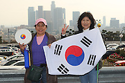 LOS ANGELES, CA - MARCH 21: The Los Angeles skyline lies in the background as fans of Korea wave flags and cheer for their team as Korea gets ready to compete against Venezuela during game one of the semifinal round of the 2009 World Baseball Classic at Dodger Stadium in Los Angeles, California on Saturday March 21, 2009. Korea defeated Venezuela 10-2. (Photo by Paul Spinelli/WBCI/MLB Photos)