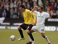 Photo: Leigh Quinnell.<br /> Watford v Luton Town. Coca Cola Championship. 09/04/2006. Watfords Chris Eagles gets the ball ahead of Lutons Ahmet Brkovic.