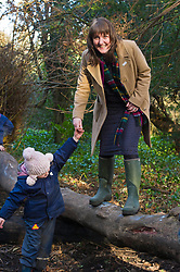 Pictured: Maree Todd needed some help on the slippery log from Daphne Shaw (4)<br /> Minister for Early Years and Childcare, Maree Todd today met a kindergarten class taking part outdoor learning at Luariston Castle Edinburgh.<br /> <br /> <br /> Ger Harley | EEm 22 February 2018