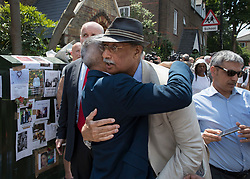 © Licensed to London News Pictures. 18/06/2017. London, UK. London Mayor Sadiq Khan receives a hug from a local resident after attending a Sunday service at St Clements church near site of the burnt out Grenfell tower block . The blaze engulfed the 27-storey building killing dozens - with 34 people still in hospital, many of whom are in critical condition. The fire brigade say that they don't expect to find anyone else alive. Photo credit: Peter Macdiarmid/LNP
