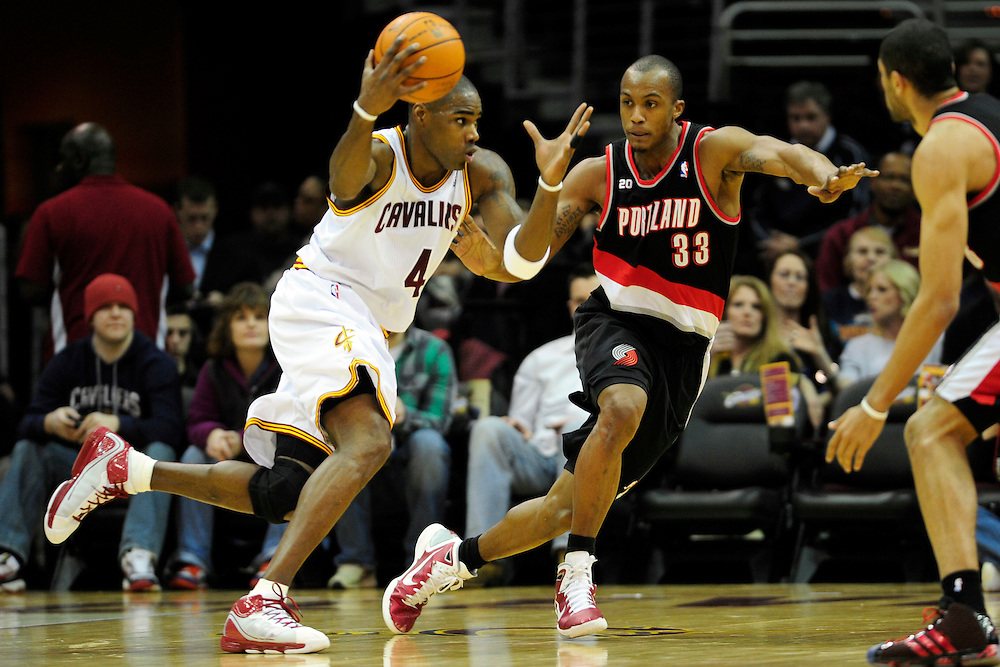 Feb. 5, 2011; Cleveland, OH, USA; Cleveland Cavaliers power forward Antawn Jamison (4) drives around Portland Trail Blazers forward Dante Cunningham (33) during the first quarter at Quicken Loans Arena. Mandatory Credit: Jason Miller-US PRESSWIRE