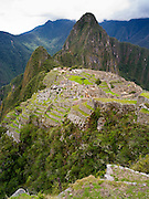 The Incan ruins of Machu Picchu, with Huayna PIcchu rising in the background, near Aguas Calientes, Peru.