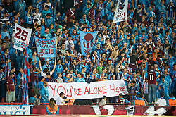 TRABZON, TURKEY - Thursday, August 26, 2010: Trabzonspor's supporters with a banner 'You're Alone Here' before the UEFA Europa League Play-Off 2nd Leg match against Liverpool at the Huseyin Avni Aker Stadium. (Pic by: David Rawcliffe/Propaganda)
