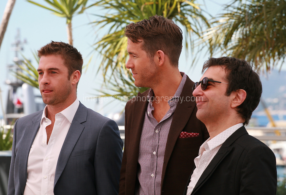Scott Speedman, Ryan Reynolds and Director Atom Egoyan at the photocall for the film Captives at the 67th Cannes Film Festival, Friday 16th May 2014, Cannes, France.