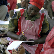 Ludzibini, Swaziland                               October, 2004..A woman takes notes during a community meeting in Ludzibini, Swaziland held October 17, 2004. Photo by Lori Waselchuk/South Photographs