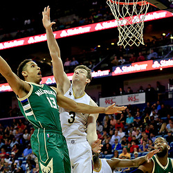 Nov 1, 2016; New Orleans, LA, USA; Milwaukee Bucks guard Malcolm Brogdon (13) shoots over New Orleans Pelicans center Omer Asik (3) during the first quarter of a game at the Smoothie King Center. Mandatory Credit: Derick E. Hingle-USA TODAY Sports