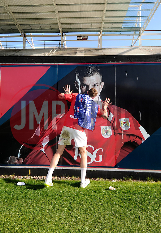 Bristol City's Aden Flint kisses a photo of himself as Bristol City are crowned champions of League One - Photo mandatory by-line: Joe Meredith/JMP - Mobile: 07966 386802 - 18/04/2015 - SPORT - Football - Bristol - Ashton Gate - Bristol City v Coventry City - Sky Bet League One